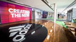 AKTIE IM FOKUS: Adidas sehr fest - Berichte über Reebok-Offerte